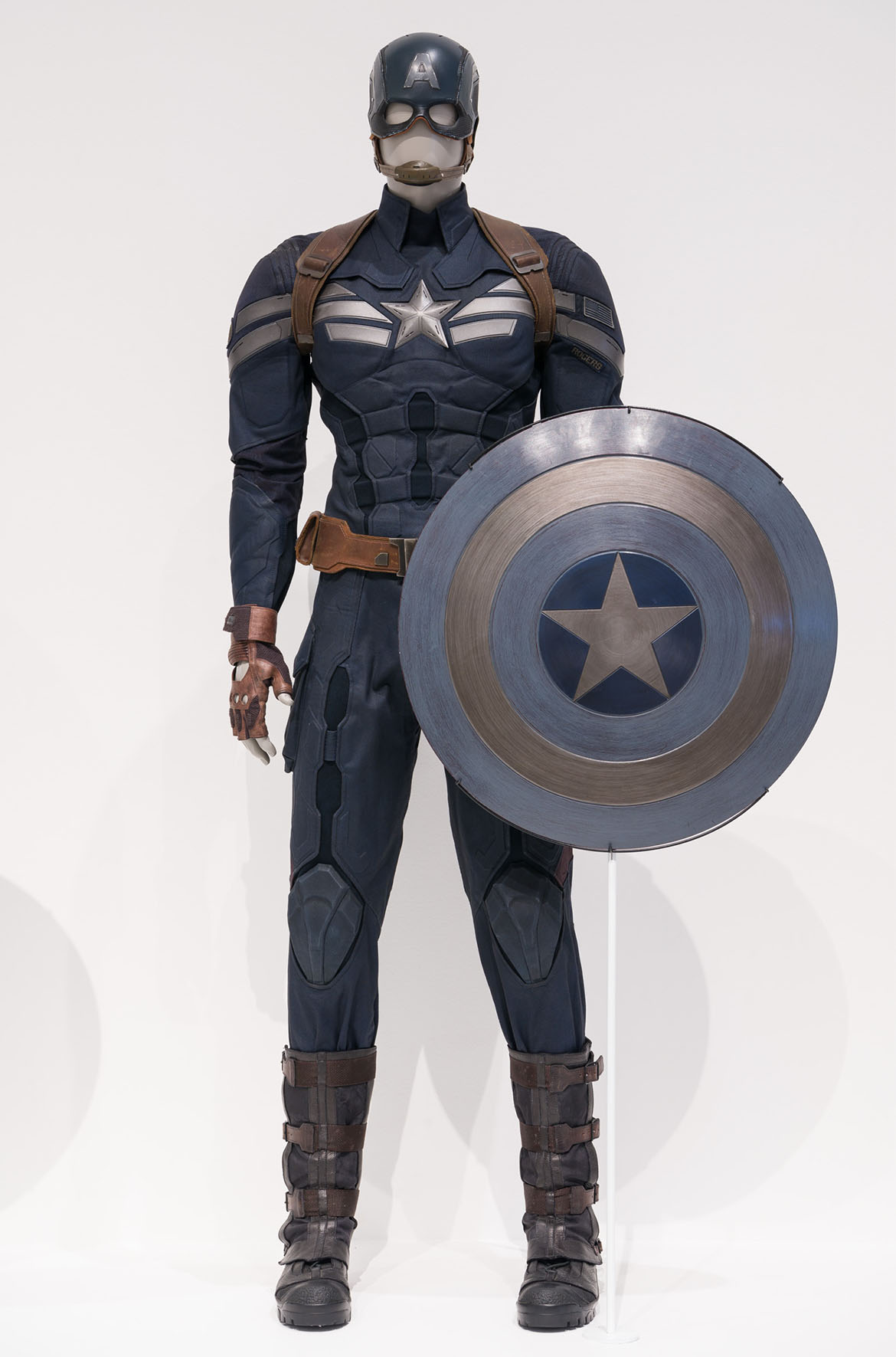Installation view of Captain America's suit and shield, 'Captain America: Living legend' room, 'Marvel: Creating the Cinematic Universe', GOMA 2017